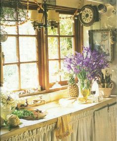 An English Cottage. My grandma's kitchen didn't look anything like this one, but the feel of it completely reminds me of her.