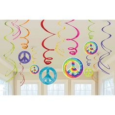 Make your party far out! The Feelin' Groovy Swirl Decoration Value Pack has what you need. This righteous decoration pack includes colored metallic swirls in varying sizes, and a few large, tie-dye pe