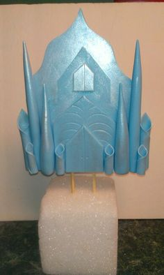 Frozen inspired Elsa's ice castle made from gum paste and sprayed with luster dust