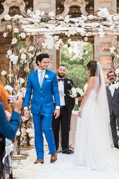 hola - Vue Photography Getting ready for I do! Vizcaya Museum and Gardens dress by: Mira Zwillinger Grooms suit: Michael Andrews Bespoke