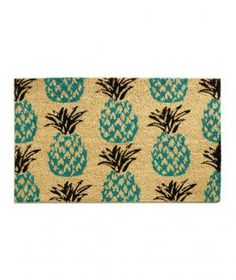 The pineapple, a symbol of hospitality, will make guests feel immediately welcome on your doorstep. Made of coconut husk fibers, this durable mat can be shaken or swept clean to keep the fruit looking fresh.