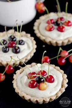 vanilla&lemon cream tartlets with cherries on top