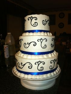 White/royal blue/black wedding cake