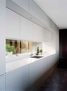 46 Great Examples of White Contemporary Kitchen Cabinets Long Narrow Kitchen, House, Kitchen Window, Contemporary Kitchen Cabinets, Modern Kitchen, Contemporary Kitchen, Kitchen Layout, Minimalist Kitchen, Kitchen Style