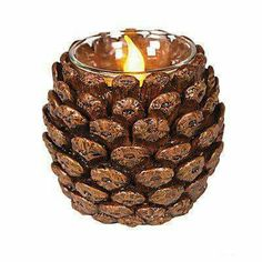 Pinecone Votive Holder Bring the feel of winter and the holidays to your tables. Just add battery-operated candles and enjoy the soft, flickering glow. Buy a few as Christma . Nature Crafts, Fall Crafts, Holiday Crafts, Summer Crafts, Kid Crafts, Craft Projects, Pine Cone Art, Pine Cone Crafts, Acorn Crafts