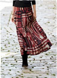 A painterly abstract plaid, the silky rayon (55%) and cotton (45%) maxi skirt is styled with unpressed pleats cascading from a contoured yoke; ankle-grazing hem .#PeruviianPicks