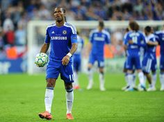 Didier Drogba looks to the skies before scoring the winning penalty...