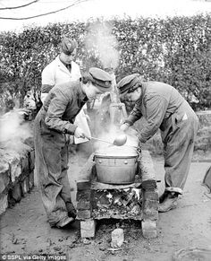 Action stations: Members of the Army Catering Corps are put through their paces during a training course in the early years of the war ~