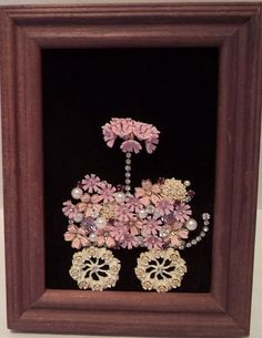 A cute Flower cart With Umbrella and purple flowers in a 4 by6 purple wood frame on black velvet.Made with vintage jewelry. Thanks for