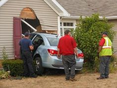 Workers with Jackson-Belden Towing pull a Chevy Cruze from a Jackson Township home July 17. According to police, the woman driving the car failed to navigate the curve in front of the house, lost control of the vehicle and crashed into the guest bedroom at the front of house at 4072 Lindbergh Road NW.