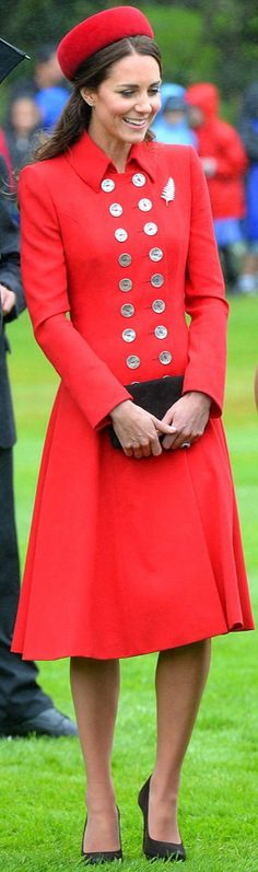 "Catherine, Duchess of Cambridge, aka Kate Middleton, at the official welcome ceremony at Government House, in Wellington, NZ. She is wearing the Russian Greatcoat by Catherine Walker, the ""Seaford"" style hat by Gina Foster, brown suede Emmy clutch and heels, and a diamond and platinum brooch in the shape of a fern (a national symbol of New Zealand), on loan from HM the Queen. 4/07/14"