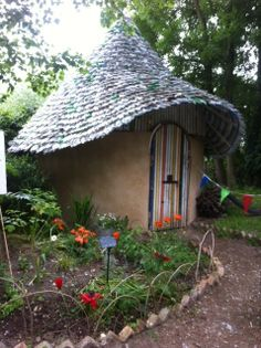 cob cottage with plastic bottle roof