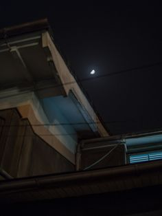moon and roof of public bathhouse | by ymk.sato