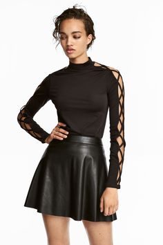 65920a84d3f6 Fitted top in glossy jersey with a small stand-up collar and long sleeves  with open sections and narrow cross-over straps.