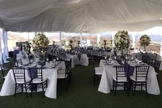 White Pintuck Table Linens with Blueberry Pintuck Table Runners.  Photo courtesy of Allie's Party.  GBS Linens