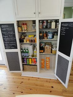 Pantry with chalkboard paint inside doors.  Could use metal and magnets too to clear it off the fridge.