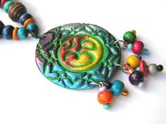 Aum om necklace, drop-shape, bohemian, boho, gypsy, iridescent , wood beads