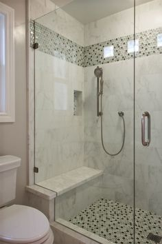 Contemporary 3/4 Bathroom with Arizona Tile, Manhattan, Marble., Handheld Shower Head, frameless showerdoor, Master bathroom