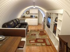 Interestingly liveable transformation of a corrugated survival shelter! Underground Homes: Atlas Survival Shelters Underground Bunker Plans, Underground Survival Shelters, Underground Shelter, Underground Homes, Underground Living, Modern Tiny House, Tiny House Living, Tiny Cabins, Cabins And Cottages