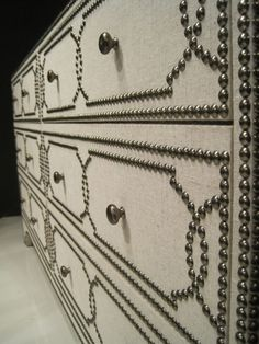 Nailhead over fabric covered dresser (do this with expedit door inserts - white fabric, nailheads, burnished brass pulls and legs):