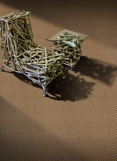 I looked up carpets in Johannesburg. I don't want to buy a carpet and I have no connection with Johannesburg. I signed up for their newsletter and spent a few minutes browsing carpets. It was worth it just to find this incredible piece of furniture on top of one of the carpets on display.
