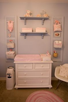 Shutters in nursery! Diaper storage off of the changer surface, but close by!
