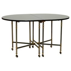 """""""Royale"""" Expanding Table with Leaves by Maison Jansen   From a unique collection of antique and modern dining room tables at https://www.1stdibs.com/furniture/tables/dining-room-tables/"""