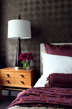 Add some cozy to contemporary. Sean Cowan of Sean Michael Design used wallpaper to add a more intimate and cozy feeling to this contemporary bedroom.