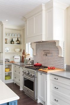 Attention Grabbing Focal Point Grise Savoie and Thassos Marble Backsplash