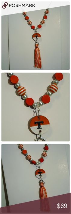UT VOLS tassel long silver necklace earrings gift PRICE FIRM. Handcrafted gorgeous trendy orange and white tassel necklace with hand crafted orange and white wooden pendant with silver T and matching orange and white beads. Silver chain.  Matching orange and white earrings with silver pendant T. No returns. Ask any questions before purchasing. 🚫trades, 🚫returns. ask Q's ❤️PRICE FIRM unless bundled❤️HIGH QUALITY sassy classy jewelry Jewelry Necklaces