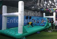 inflatable rugby themed bungee game