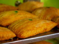 Descended from the British turnover, Jamaican beef patties liven up an old standby with a big pinch of curry and the fiery punch of the Scotch bonnet pepper. Jamaican beef patties have spread in popularity with immigrant populations to places like England, Toronto, New York and southern Florida. Make them small for appetizers or large for a serious entree. 4 to 6 servings Ingredients Pastry