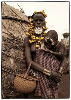 Africa | People. Mursi woman and child. Ethiopia