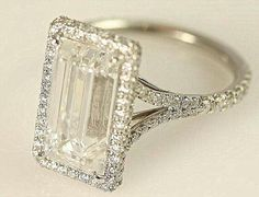 Yep, this is totally me. Huge emerald cut diamond with micro pavé diamonds on halo and split shank.