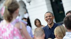 Obam-ha: The president enjoys a hearty laugh while mingling with guests on the South Lawn
