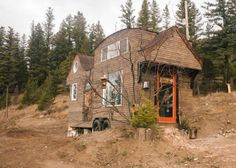 This is the Esk'et Tiny House Bed and Breakfast. From the outside, you'll notice a unique roof life, wood siding, and a fun burnt orange door. When you go inside, you'll find a ki…