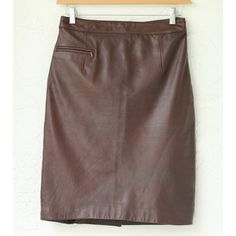 """Chocolate/ Brown Aged leather skirt (8) ❤️ BUNDLES  ❤️ Discounts on Bundles  ❌ NO TRADES  ❌ NO Low Balling!!   • Pre-Owned •  •Excellent Condition•  *MEASUREMENTS: - Size: 8 - Waist: 30"""" Approximately - length: 23"""" Approximately  *MATERIAL: - Outshell: 100% Genuine Leather - lining: 100% Polyester •Clean ONLY by professionals• Skirts Midi"""