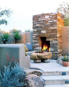 Instead of a fire pit, install a fireplace outdoors! Brings a traditional feel to the space to make it feel like an extension of your home's living space!