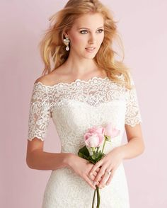 This strapless all-lace gown features a soft mermaid silhouette, and a removable lace bolero.See Allure Bridals