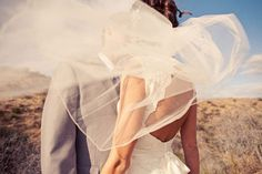 Different take on the couple-kissing-behind-veil photo