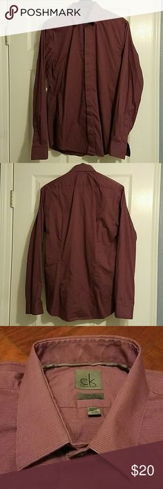 """Men's CK Calvin Klein Dress Shirt 15.5-34/35 Calvin Klein dress shirt. Slim fit, stretch. Neck 15.5"""", sleeve 34""""/35"""". Burgundy color, small checkered pattern. Worn a few times but still in good condition. Color and sleeves in good shape. Slight discoloration on inside neck collar (see pictures). Calvin Klein Shirts Dress Shirts"""