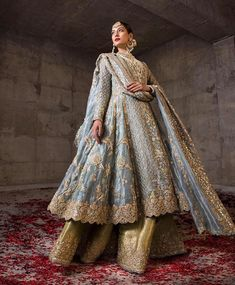 Blue bridal suit with golden embroidery is an absolute stunner. Pakistani Formal Dresses, Pakistani Bridal Dresses, Pakistani Wedding Dresses, Pakistani Dress Design, Pakistani Outfits, Indian Outfits, Pakistani Gharara, Pakistani Bridal Couture, Pakistani Clothing