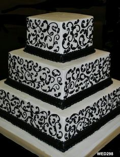 White Wedding Cake with black scrollwork and ribbon