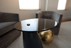 Pivot Cocktail Tables in High Gloss Lacquer Tapered Cylinder Base, Oil Rubbed Patina Brass Fittings and Tinted Tempered Oval Glass Top.