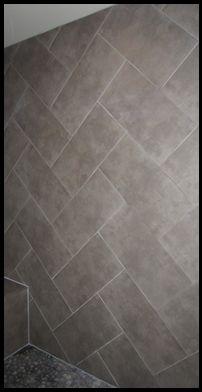 Herringbone layout of a 12 x 24 tile in a custom shower!