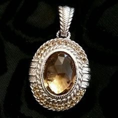 Judith Ripka Pendant Enhancer Striking bezel set center faceted stone encased by Berge cut sterling silver and matching round stones. Large bale is Berge cut sterling silver. Substantial weight. Nice on a cord or chain. I sometimes wore it on pearls!  See matching ring in separate listing!  Judith Ripka  Jewelry