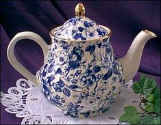 """Arthur Wood Blue and White Floral Chintz Teapot This beautiful teapot measures approx. 7"""" high by 10"""" wide."""