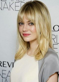 Emma Stone: Medium Length straight hair with bangs and layers Now Im thinking, really thinking bout getting this hair cut! Description from pinterest.com. I searched for this on bing.com/images