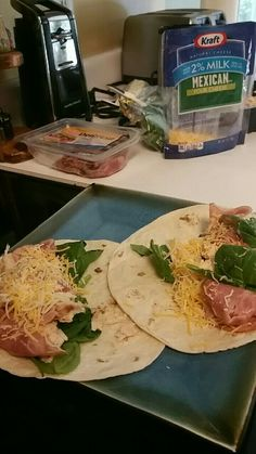 Burritos stuffed with chicken, ham, shredded cheese, and spinach