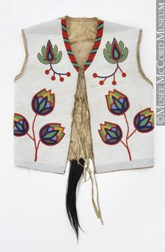 Waistcoat  -  Northern Plains  Aboriginal: Assiniboine or Nakoda  1890-1925, 19th century or 20th century  Cotton canvas, tanned and smoked hide, glass beads, hair, shell, metal beads, brass beads, wool cloth, cotton thread. Shown at McCord Museum